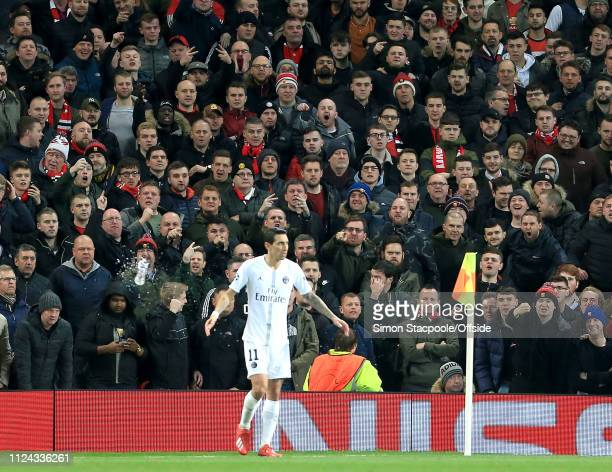 A water bottle flies past Angel Di Maria of PSG as he receives abuse from the United fans during the UEFA Champions League Round of 16 First Leg...