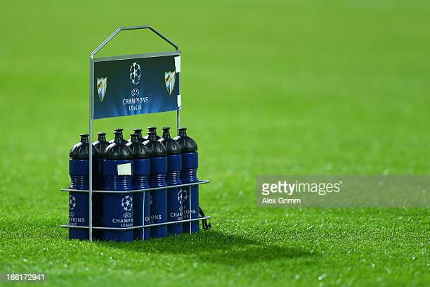 Water bottles are seen on the pitch ahead of the UEFA Champions League quarterfinal second leg match between Borussia Dortmund and Malaga at Signal...