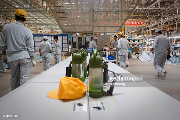 Water bottles belonging to Zhengzhou Nissan Automobile Co Ltd employees sit on a table at the plant in Zhengzhou Henan province China on Monday Sept...