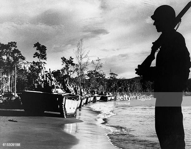 'Water Buffalo' amphibious tanks drive up the beach during the invasion of Cape Sansapor at the western end of Dutch New Guinea Coast Guardsman...