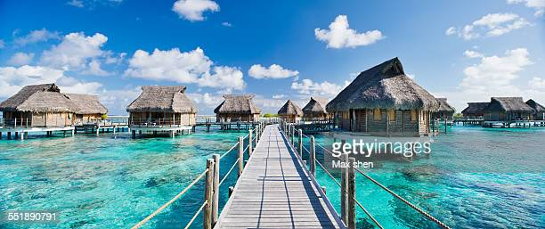 water bungalows at beach resorts in tahiti - タヒチ ストックフォトと画像