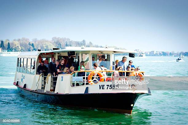 water bus on venice lagoon - vaporetto stock photos and pictures