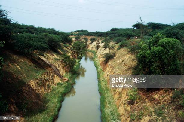 water canal in parawada, india. - canal stock pictures, royalty-free photos & images