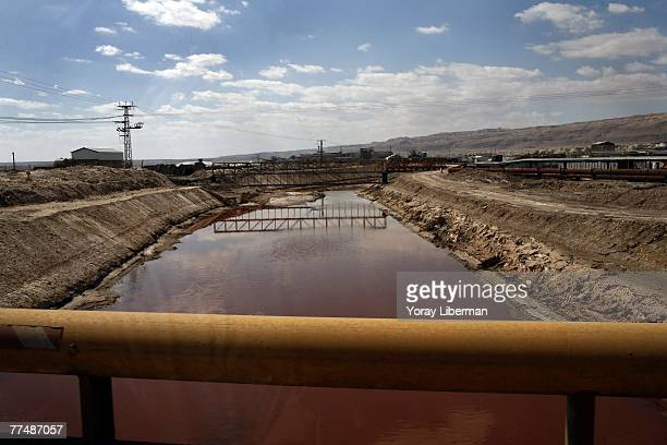 Water canals transferring water from one side of The Dead Sea Works plant to the other harvesting Potash and other chemicals out of the natural...