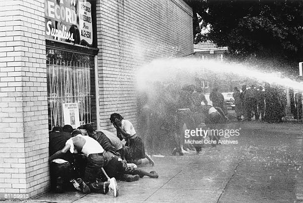 Water cannon is used on young African Americans during a protest against segregation, organized by Reverend Dr. Martin Luther King Jr. And Reverend...