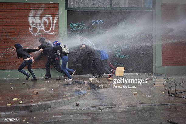 Water cannon truck repressed protesters in students march.