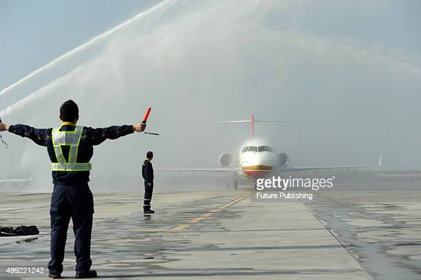 Water canons celebrate the arrival of the ARJ21 jet at the airport on November 29 2015 in Chengdu China It is the first ARJ a regional jet made by...
