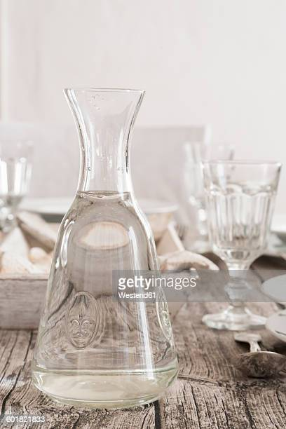 Water carafe on laid table