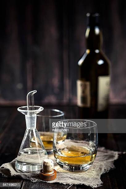 Water caraffe with spout and tumblers with Whisky