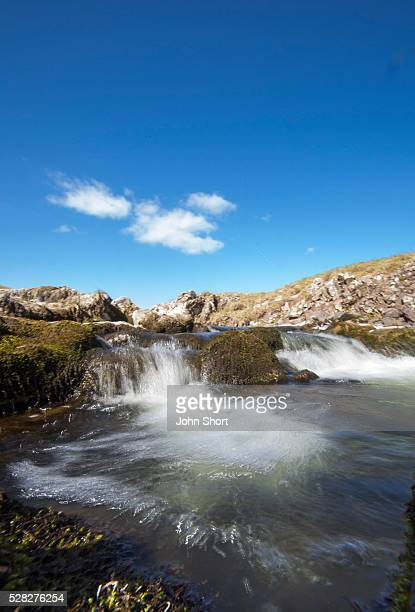 Water cascading over rocks in a river; cheviots northumberland england