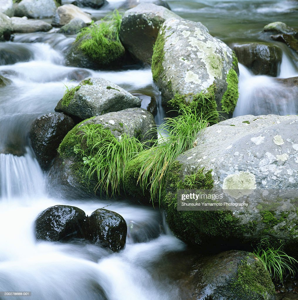 Water cascading over rocks (blurred motion) : Stock Photo