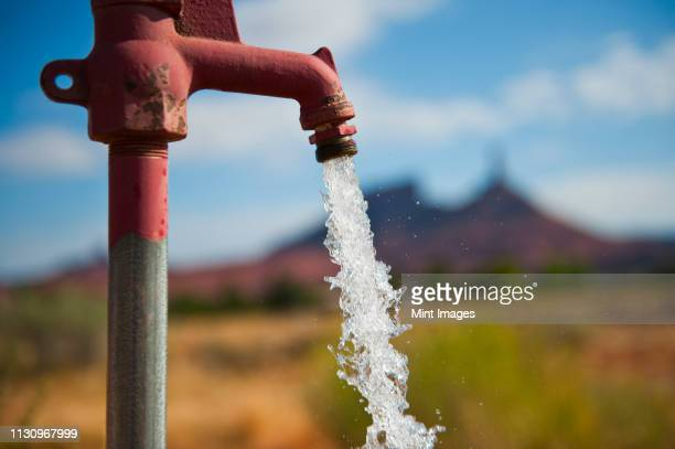 water coming from faucet - 水流 ストックフォトと画像