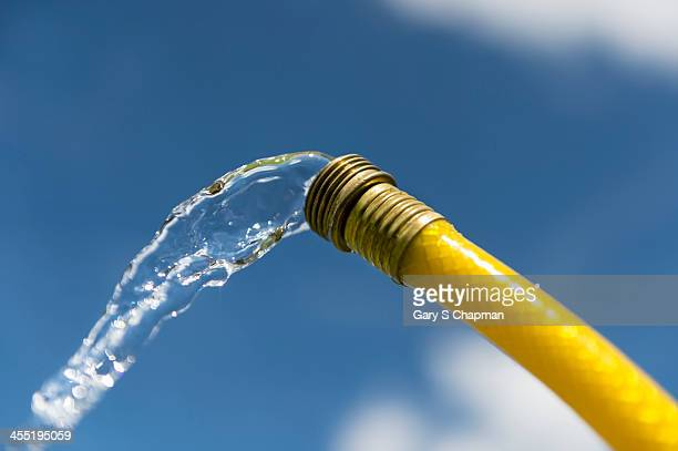 Water coming out of yellow hose