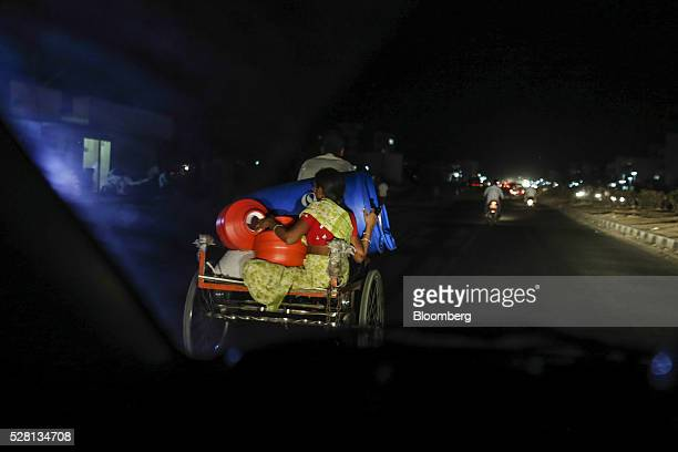 A water commuter transports empty containers on the back of a tricycle in Latur Maharashtra India on Saturday April 16 2016 Hundreds of millions of...
