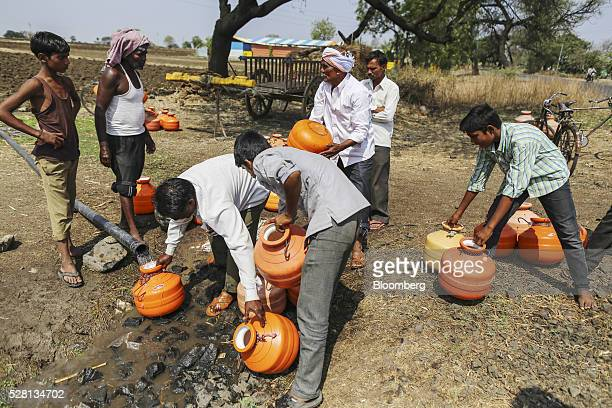 Water commuters fill containers at a groundwater source in Latur Maharashtra India on Saturday April 16 2016 Hundreds of millions of people in India...