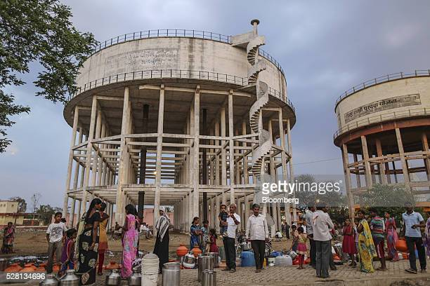 Water commuters wait in line to fill containers at the Vivekananda Chowk water tank in Latur Maharashtra India on Saturday April 16 2016 Hundreds of...
