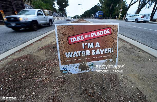 A water conservation sign remains in what was once a grasscovered traffic divider in Montery Park California on May 19 2016 The state has tatically...