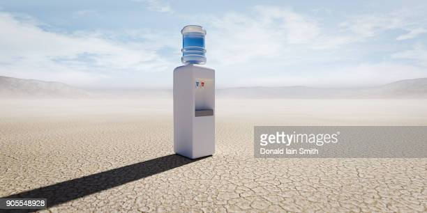 water cooler in remote desert - water cooler stock photos and pictures