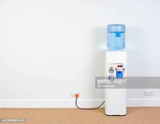 Water cooler plugged into wall in office, close-up