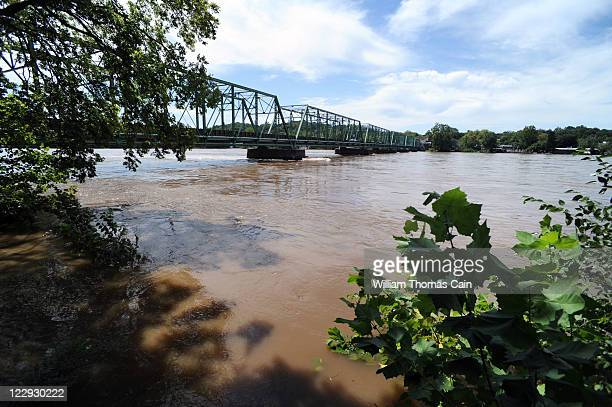 Water crests from Tropical Storm Irene near the New Hope Lambertville Bridge August 29 2011 in Lambertville New Jersey Major flooding along the...