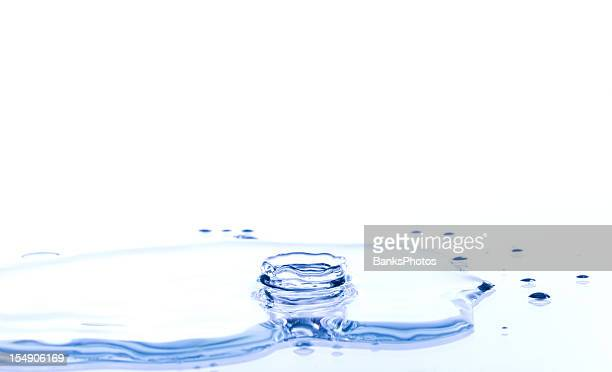 water crown splash on a reflective surface - puddle stock pictures, royalty-free photos & images