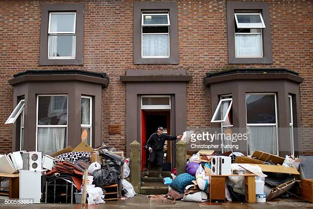 Water damaged possessions sit outside a flooded home in Carlisle after flooding created by Storm Desmond on December 9 2015 in Carlisle United...