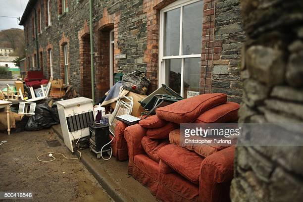 Water damaged possessions sit outside a flooded home on December 8 2015 in Keswick United Kingdom Engineers are working to reconnect thousands of...