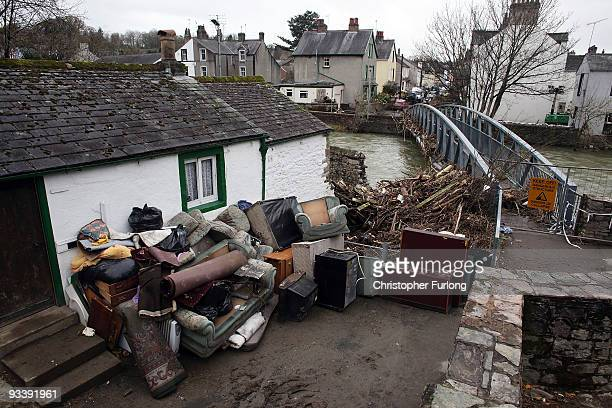 Water damaged property sits outside a house next to the River Cocker after last weeks devastating floods in Cumbria on November 25, 2009 in...