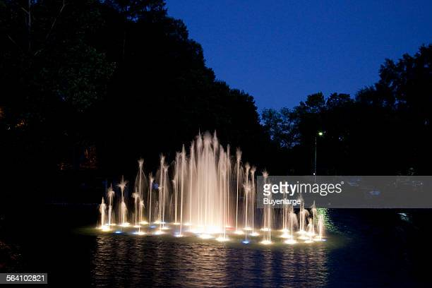 Water dances on the surface during the water show at Spring Park Tuscumbia Alabama