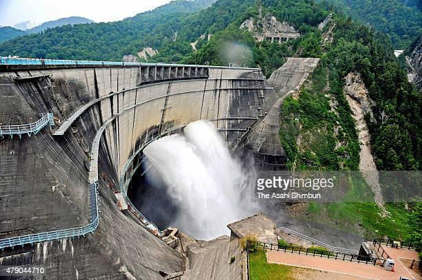 Water discharge for the spring sightseeing season begins at Kurobe Dam on June 26 2015 in Tateyama Toyama Japan