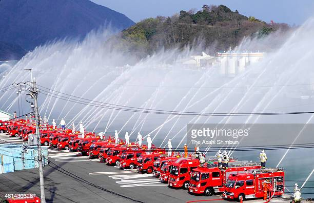 Water discharged from fire fighting vehicles during the new year fire review on January 11 2015 in Maizuru Kyoto Japan