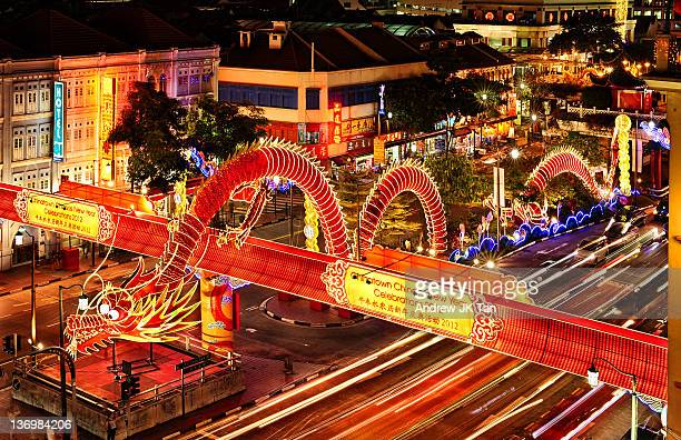 cny water dragon light trails - chinatown stock photos and pictures