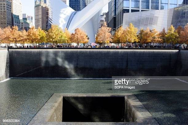 Water drains into the central well of the North Pool of the 9/11 Memorial in Lower Manhattan