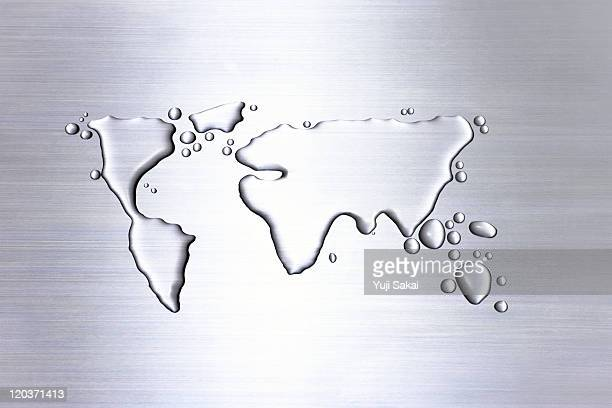 water  drawing world map  on metal  board