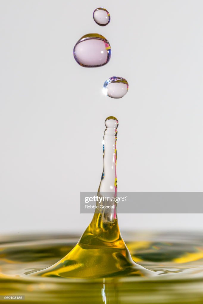 Water drip on a grey backdrop : Stock-Foto
