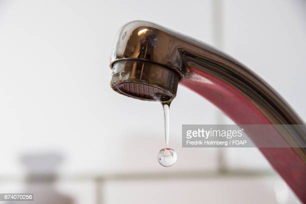 Water dripping from faucet