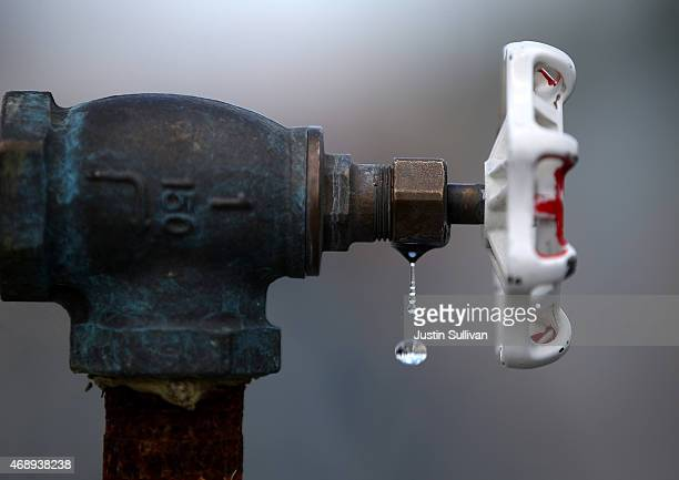 Water drips from a faucet at the Dublin San Ramon Services District residential recycled water fill station on April 8 2015 in Pleasanton California...