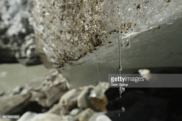 Water drips from melting ice at the Pasterze glacier on August 27 2016 near Heiligenblut am Grossglockner Austria The Pasterze glacier is Austria's...