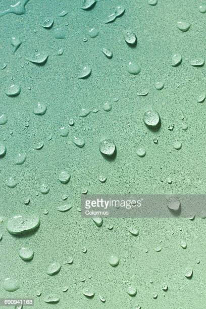 Water droplets on soft colored background