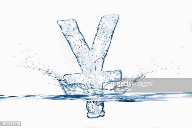 Water droplets splashing from sinking ice yuan symbol