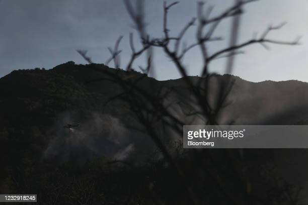 Water dropping helicopters battle flames during the Palisades Fire in the Pacific Palisades neighborhood of Los Angeles, California, U.S., on...