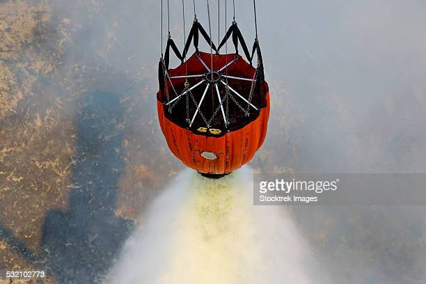 Water drops are performed using Bambi Buckets to assist the wildfires in California.