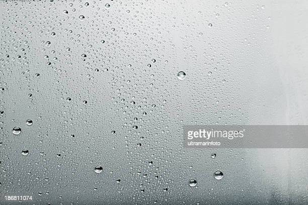 Water drops background Dew condensation texture on ice cold  glass