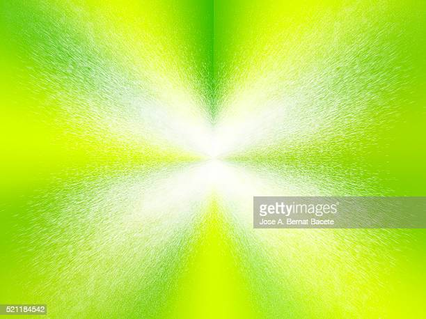 Water drops in the shape of star on a green bottom