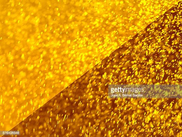 Water drops of many colors on a brown and gold  blackground