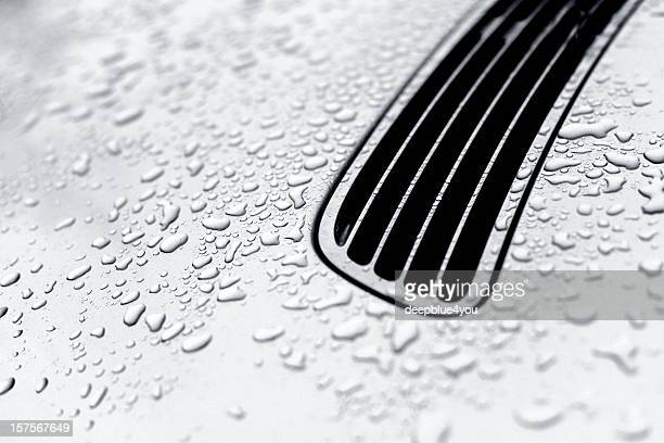 Water drops on a silver car hood