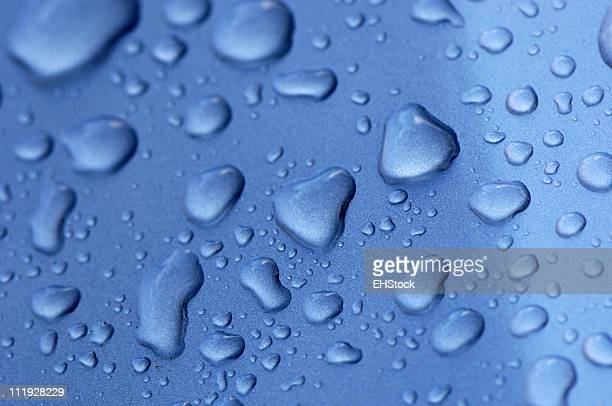 Water Drops on Blue Metal Close Up