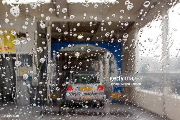 hoogeveen, netherlands - september 24, 2014: water drops on car window in car wash, netherlands - hoogeveen stock pictures, royalty-free photos & images
