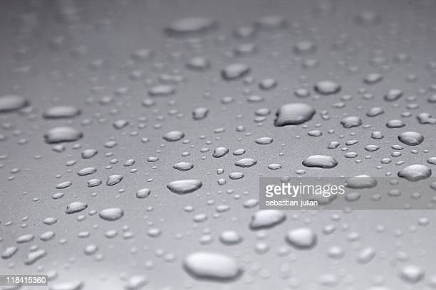 water drops on metal surface - sebastian grey stock pictures, royalty-free photos & images