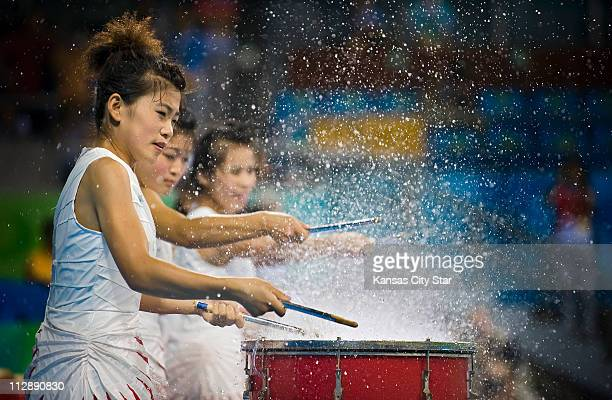 Water drummers perform at the halftime of a water polo match between the United States and Serbia on Friday August 22 in the Games of the XXIX...